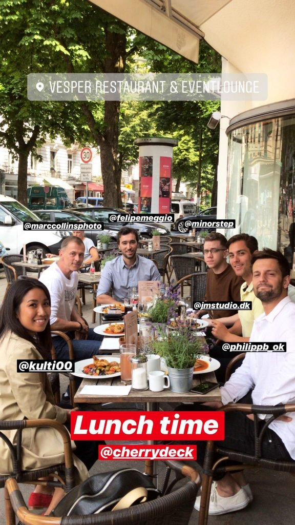 Group of people having lunch in cafe outside