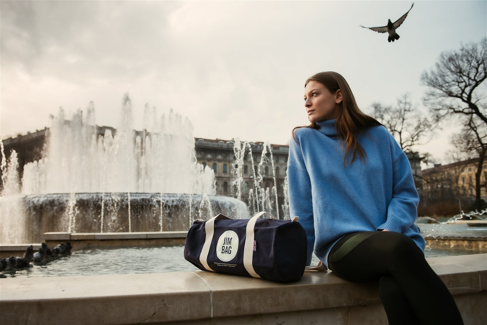 Girl in Milan fountain with jimbag shot by cherrydeck photographer Consuelo Canducci
