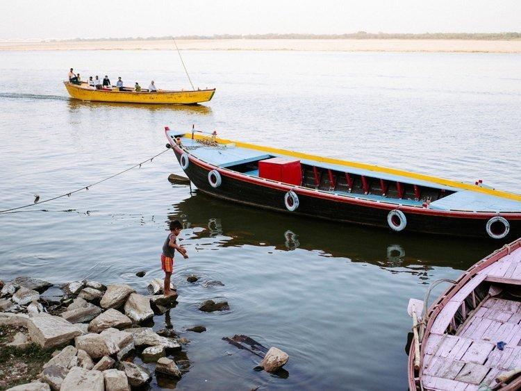 Boy fishing at Ganges in Varanasi