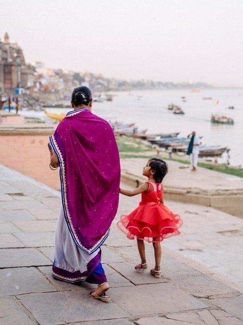Mother Daughter walking by Ganges in Varanasi