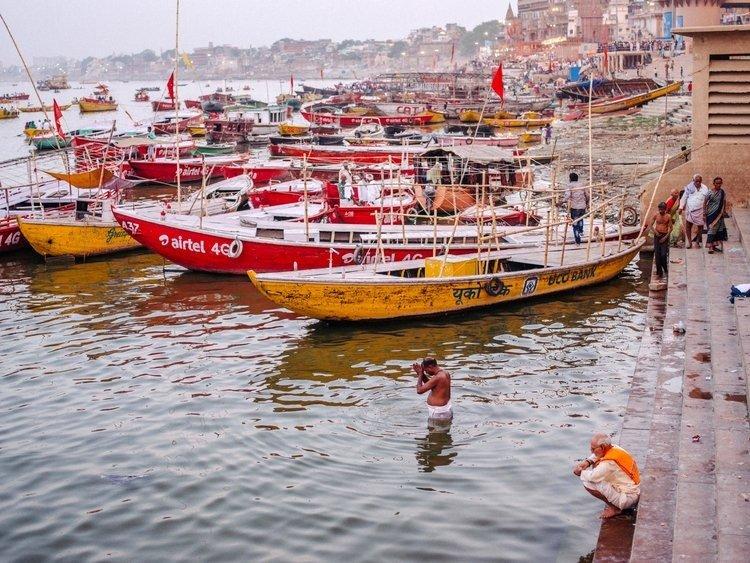 Man praying in the river Ganga