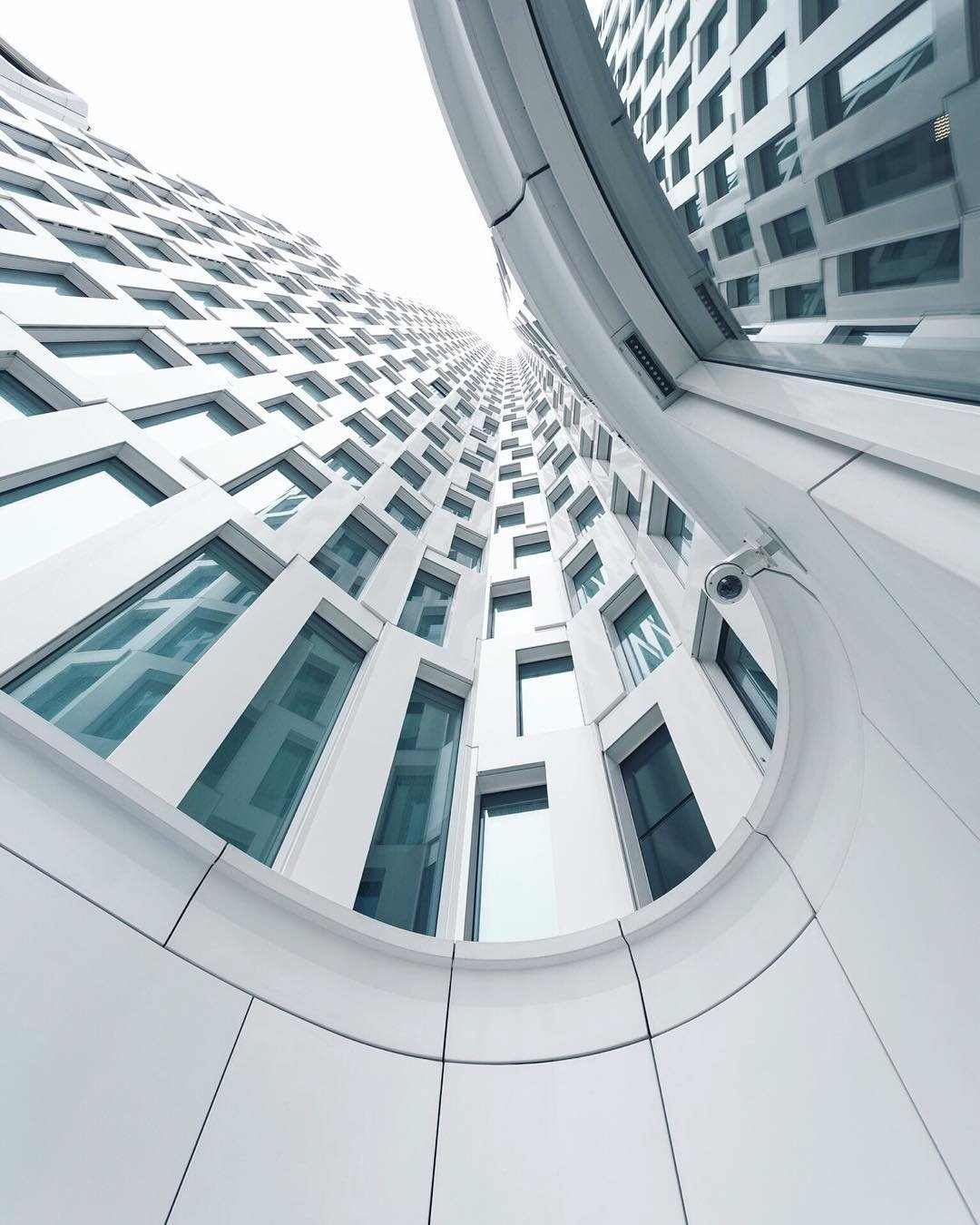 white building with windows by photographer jumpingsole