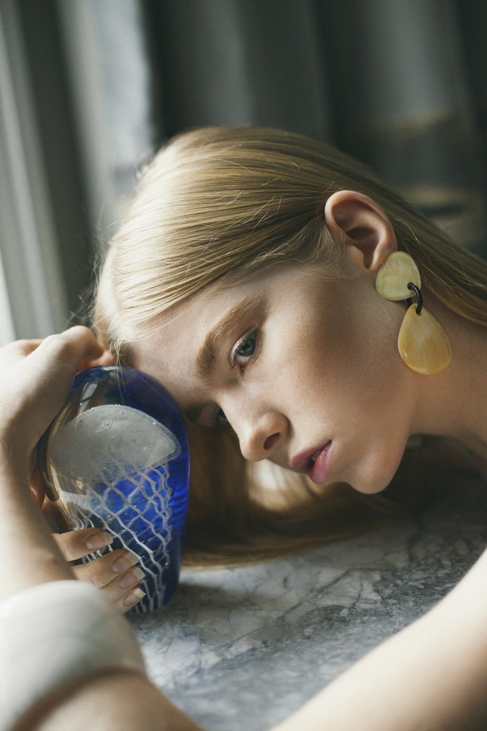 Girl holding cup: portrait by Naomi Wu