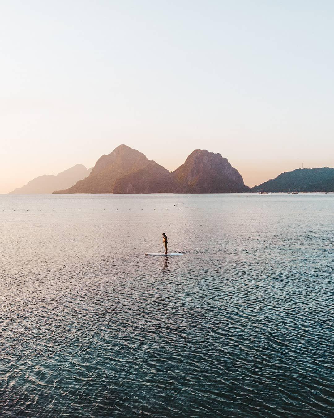 Adrian Humada sea paddle water mountain paradise calming image