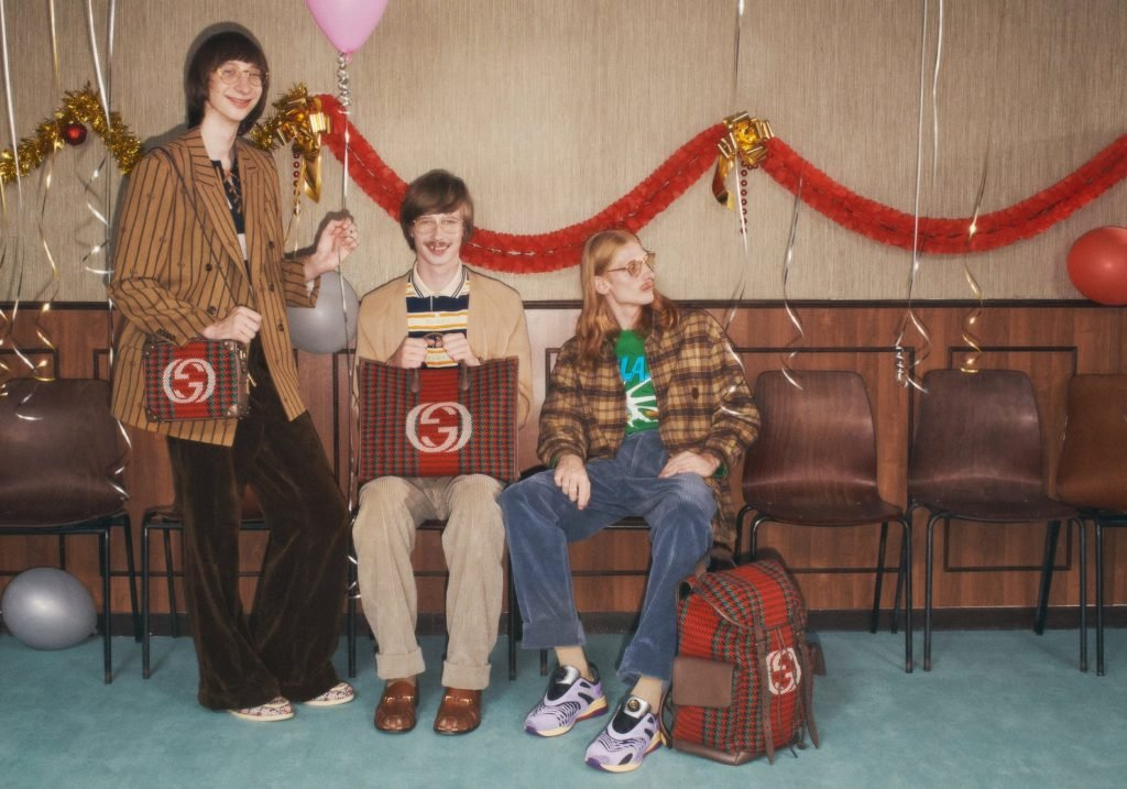 Three men smiling in the latest 90s holiday campaign from Gucci