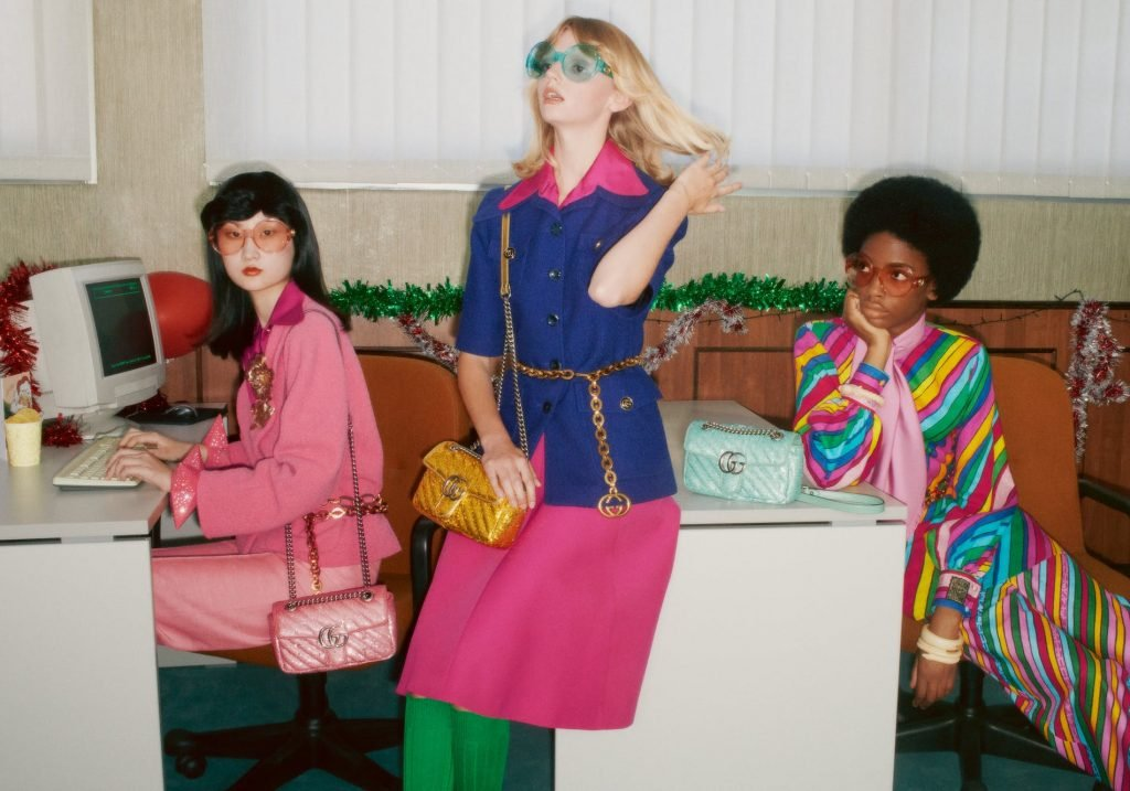 Three girls with handbags in the latest 90s holiday campaign from Gucci